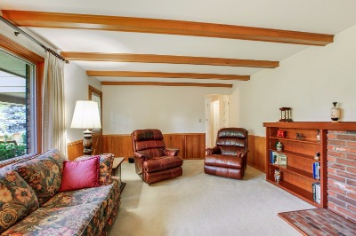 Family room with wood wainscoting and beams