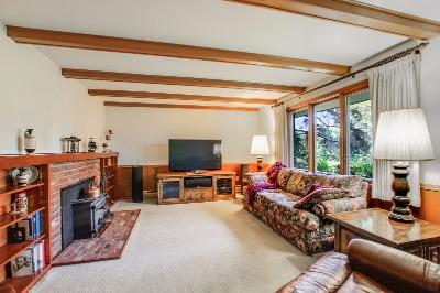 Brick fireplace, large windows