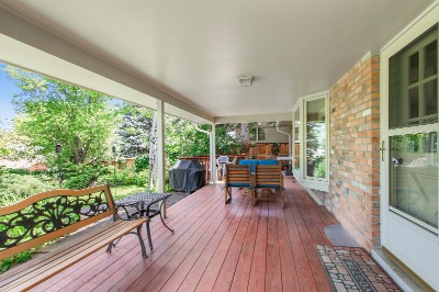 Huge covered deck to relax, look over landscaping