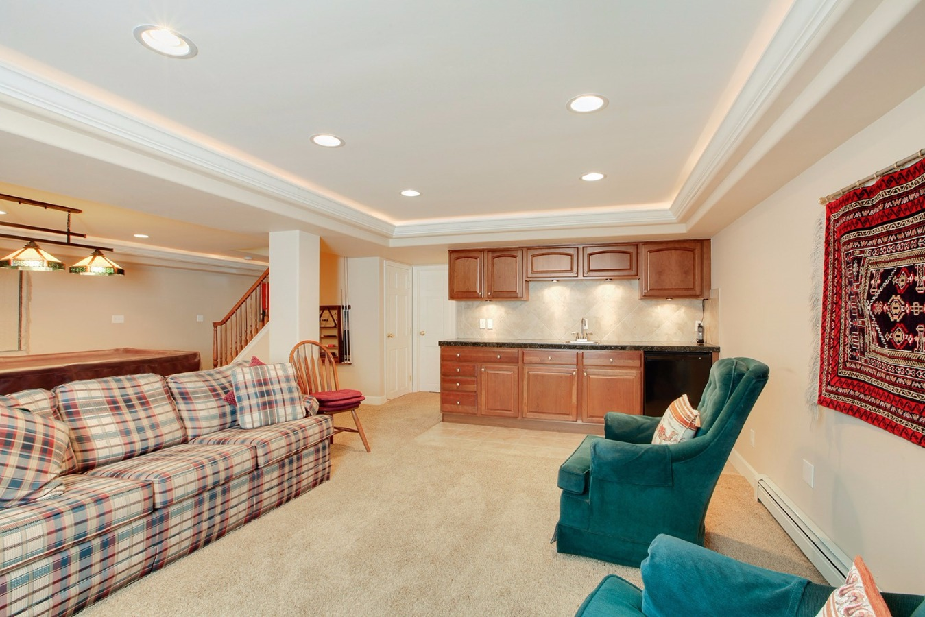Large wet bar, cabinets, open seating areas