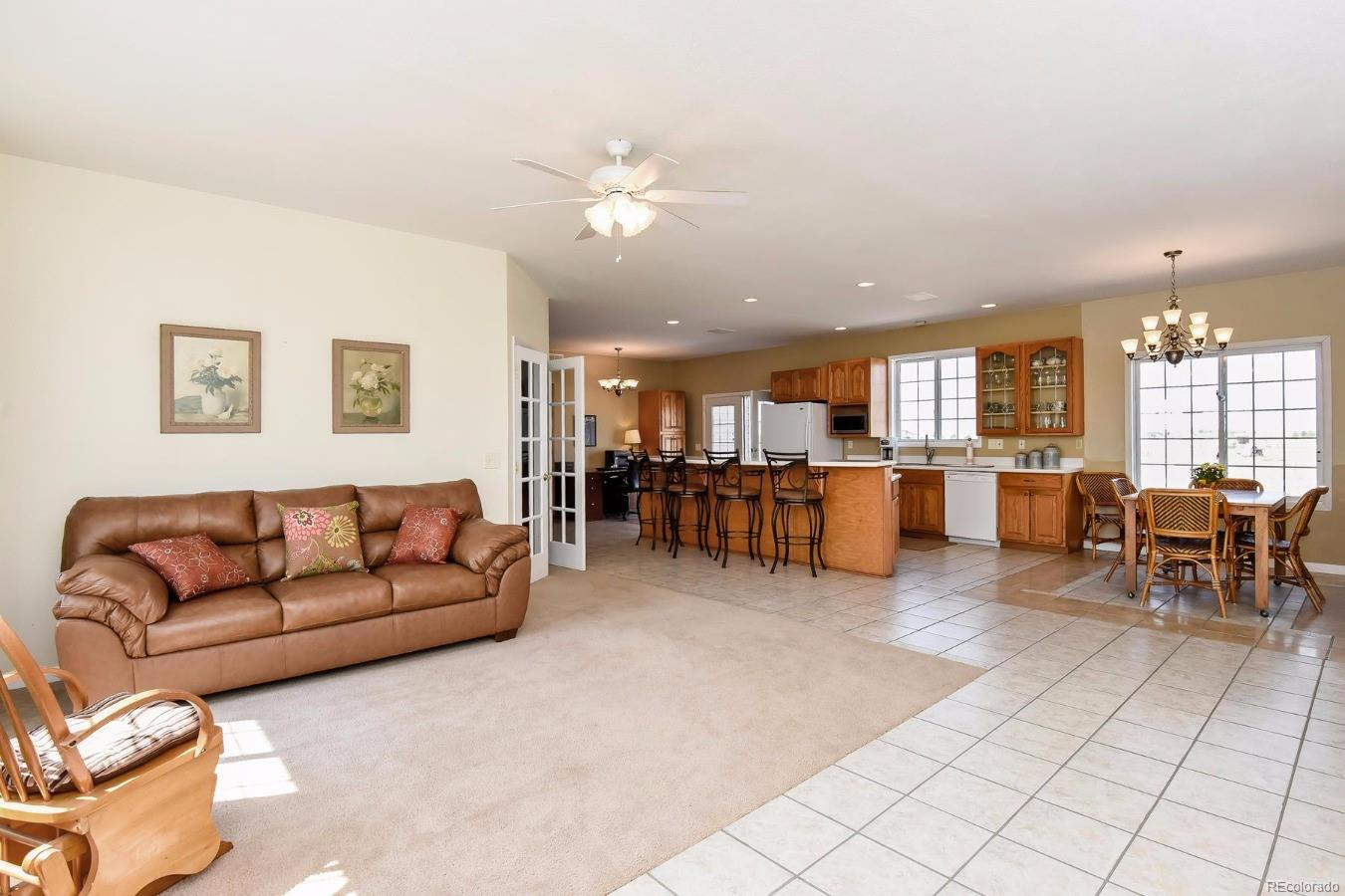 Living Room Infused with Warmth and Comfort with Lots of Usable Space for Change