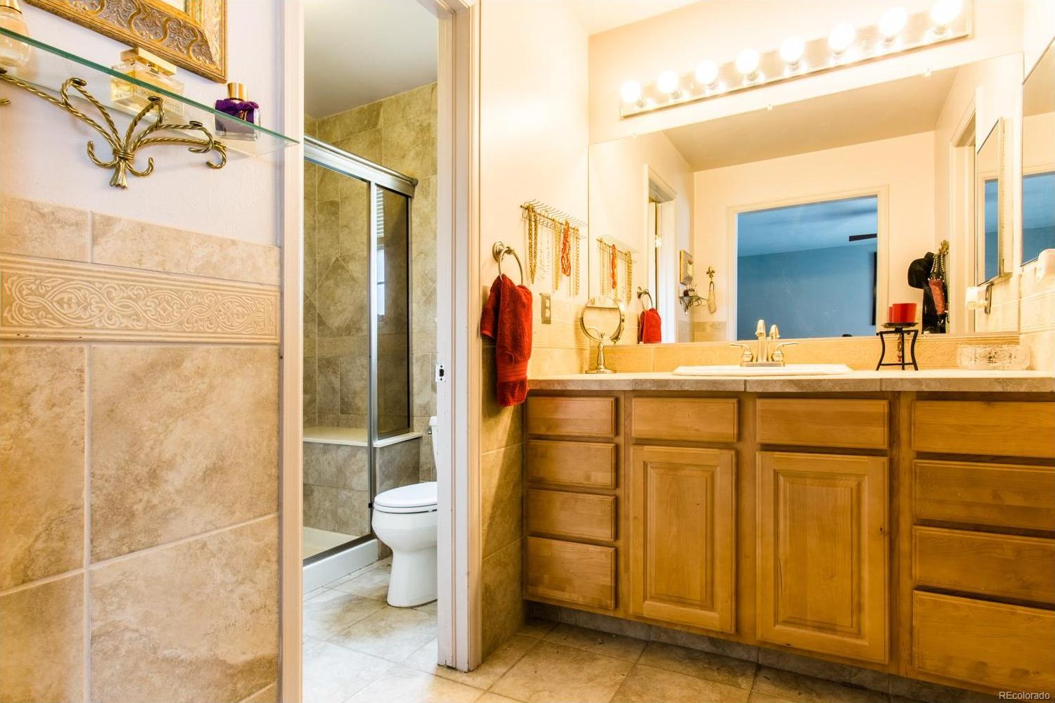 Remodeled Master Bath with large shower and walk-in closet