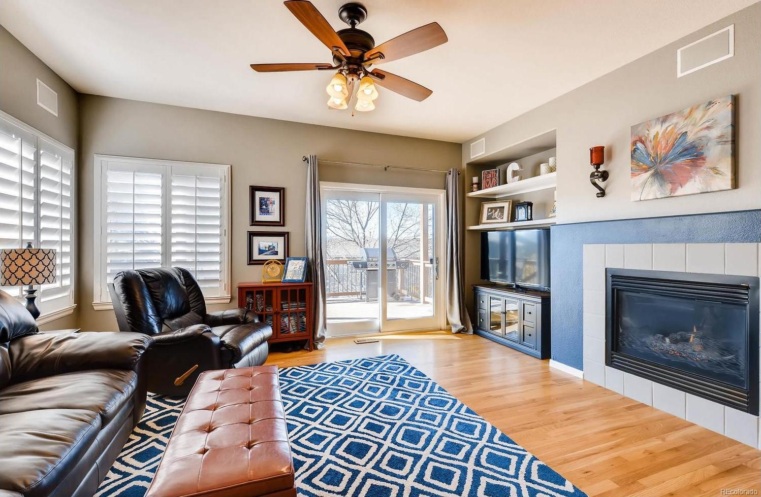 Roomy family room with gleaming hardwood floors and fireplace