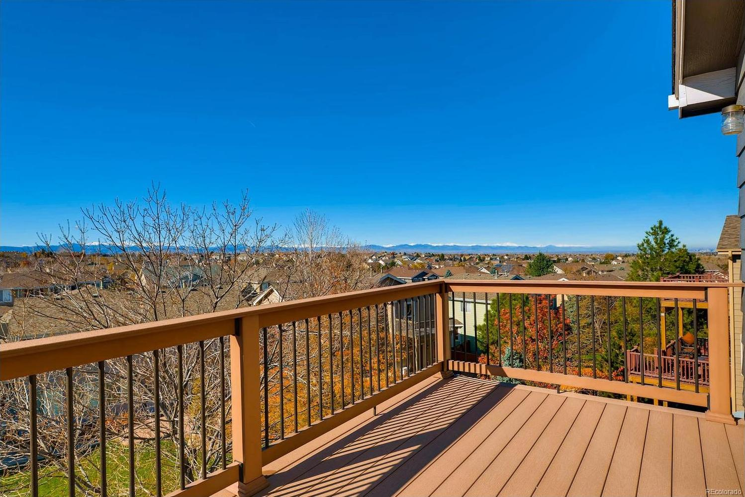 Deck with beautiful panorama mountain views off of the master bedroom