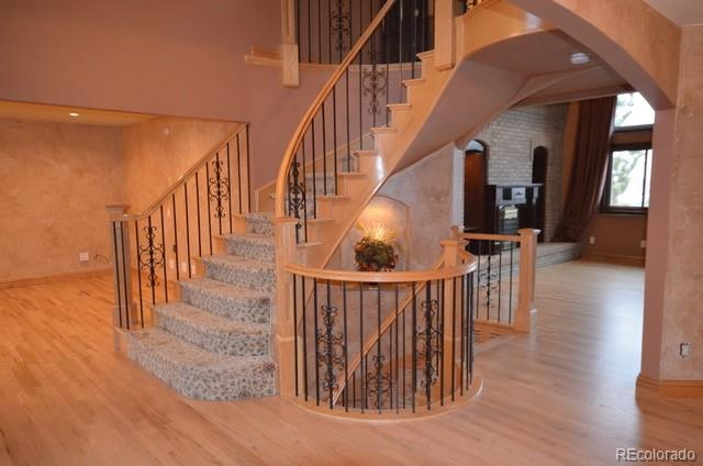 Gorgeous custom staircase open to the finished basement make this home one that