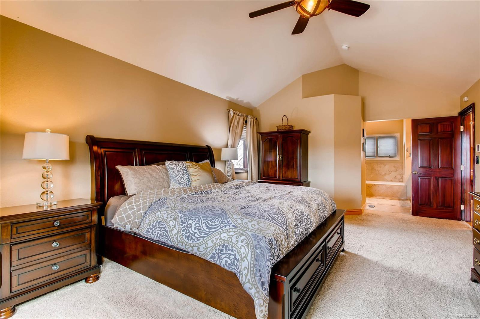 Master suite with vaulted ceilings, professionally organized closet system and p