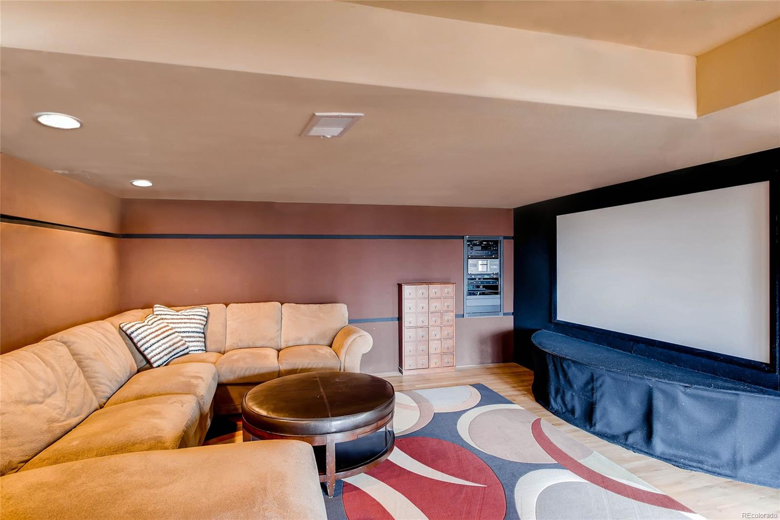 Fully finished walk out basement - theater with built in surround sound.  Screen