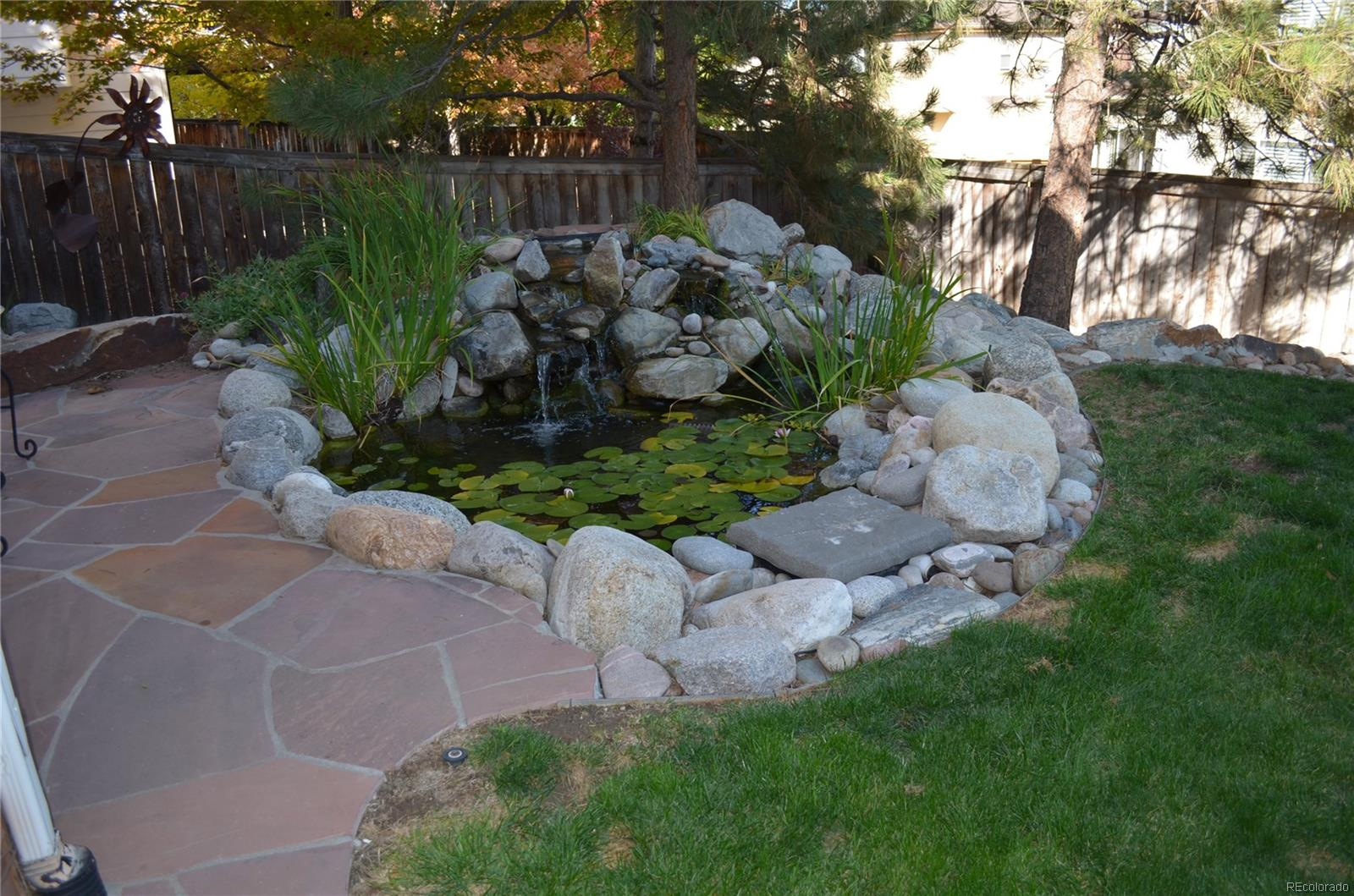 Enjoy the relaxing sound of the trickling water from the pond with water feature