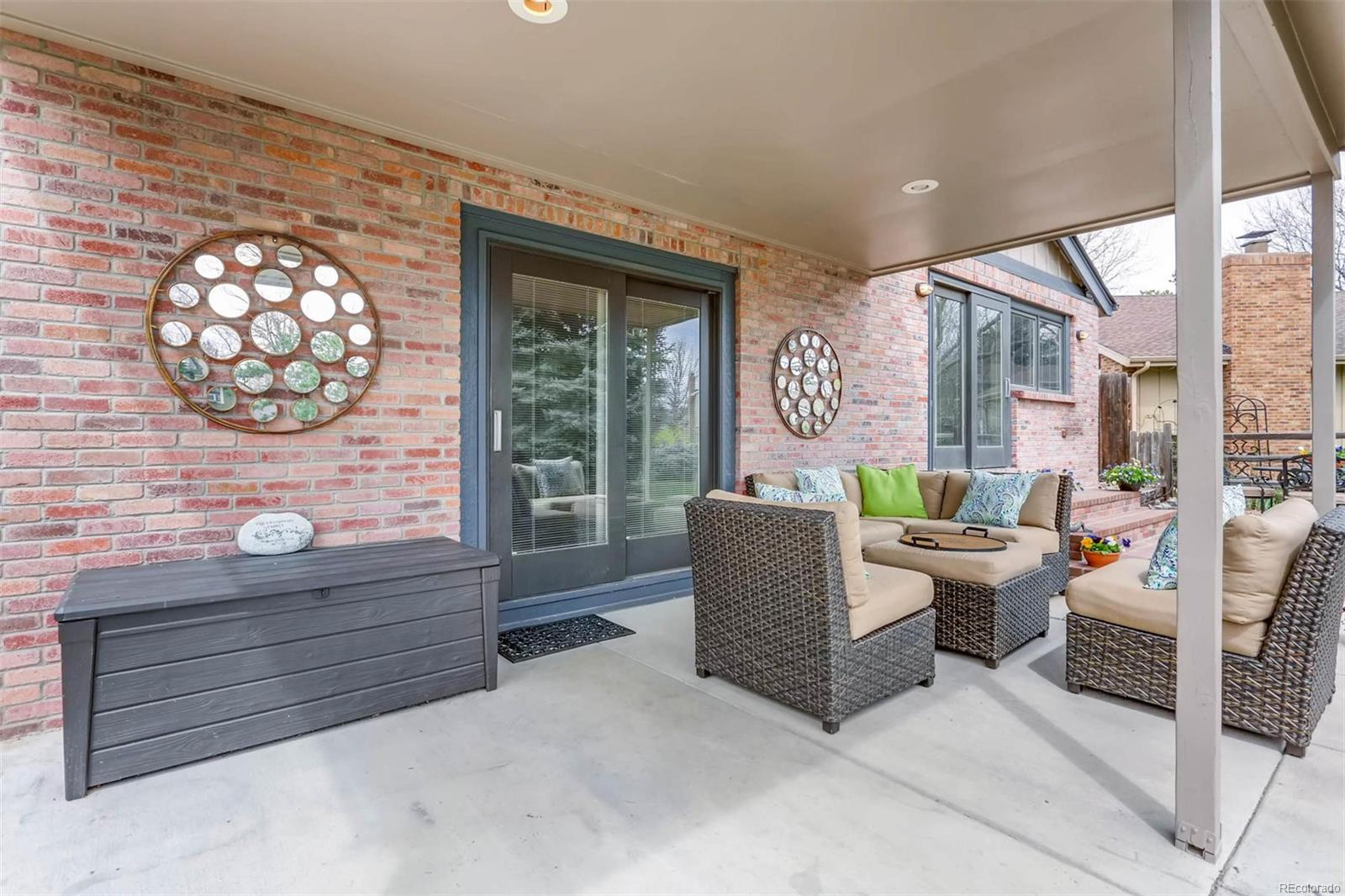Coveted covered patio in private yard on greenbelt