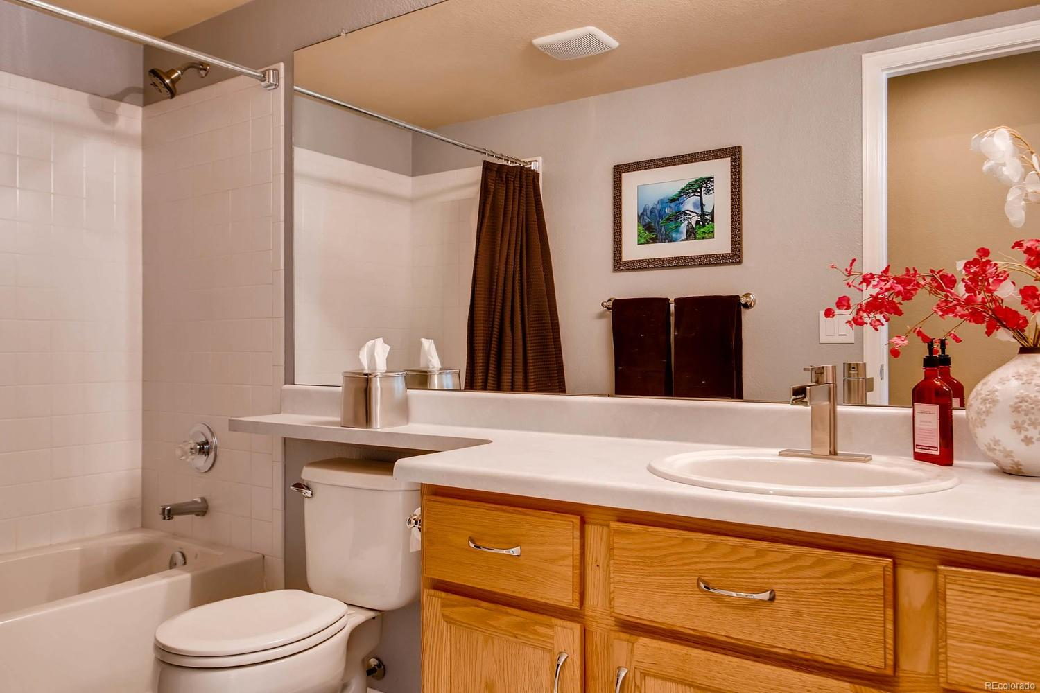 Lower level full bathroom right off of the family room and study - just at the t