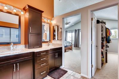Beautifully updated master bathroom with new cabinets, granite counters and unde