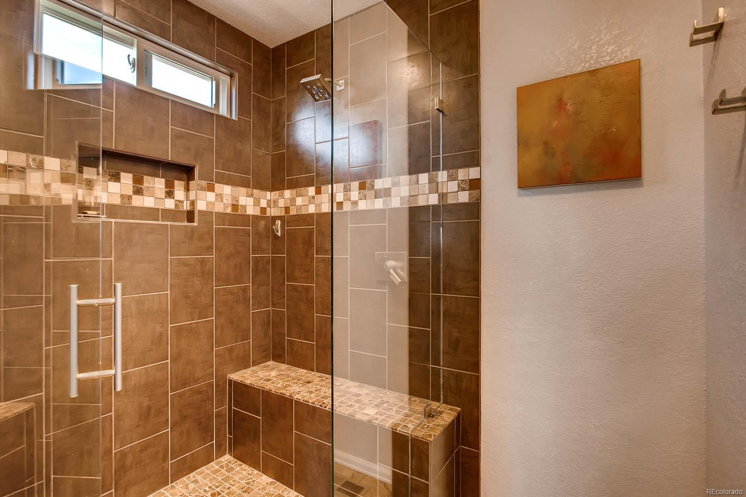 Large upgraded shower with double shower heads and frameless door
