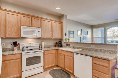 Beautiful granite counters and tile floor, all appliances included