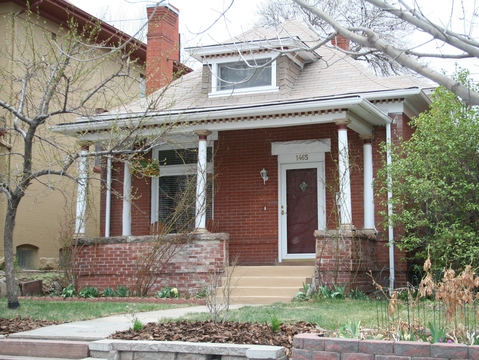 Solid brick home, with large front porch