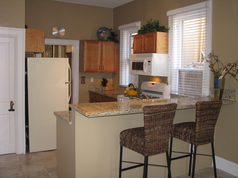 Open Kitchen with granite counters and tile floor