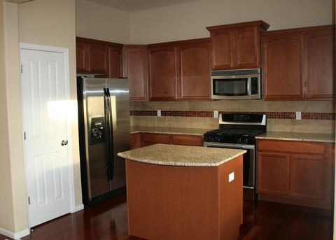Kitchen with slab granite counters, upgraded appliances