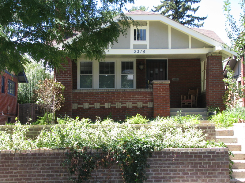 Classic Bungalow with large porch and terraced landscaping