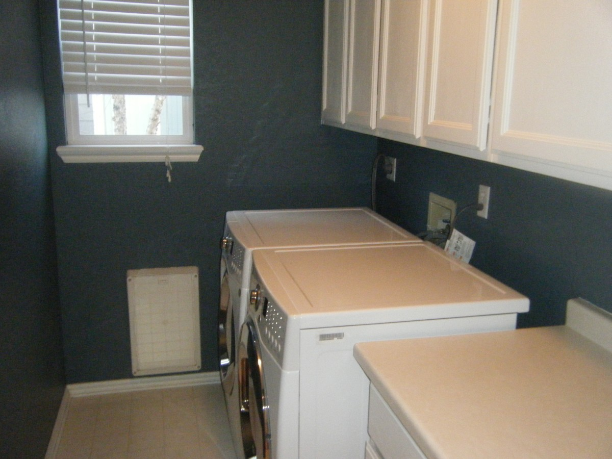 Laundry room with newer, front load washer and dryer