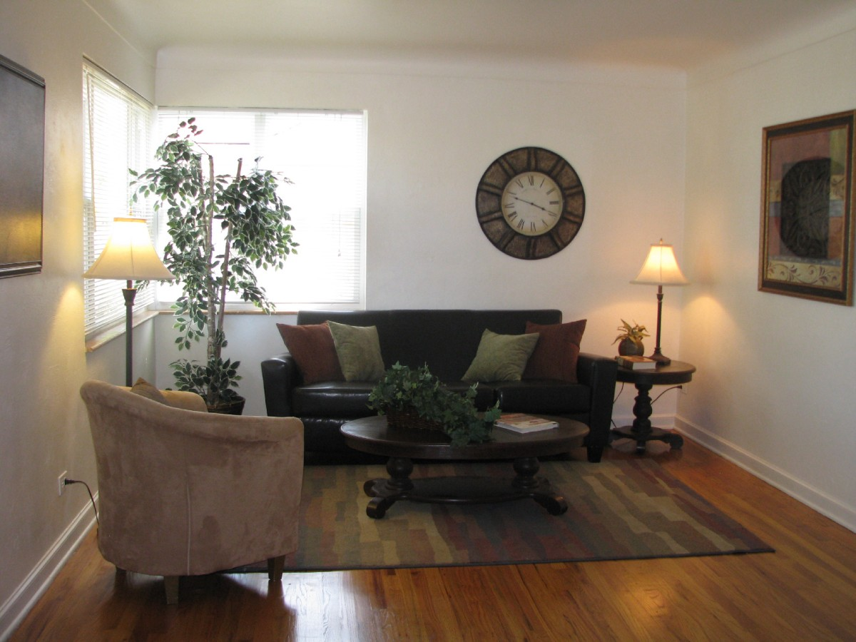 Hardwood floors and lots of light in living room