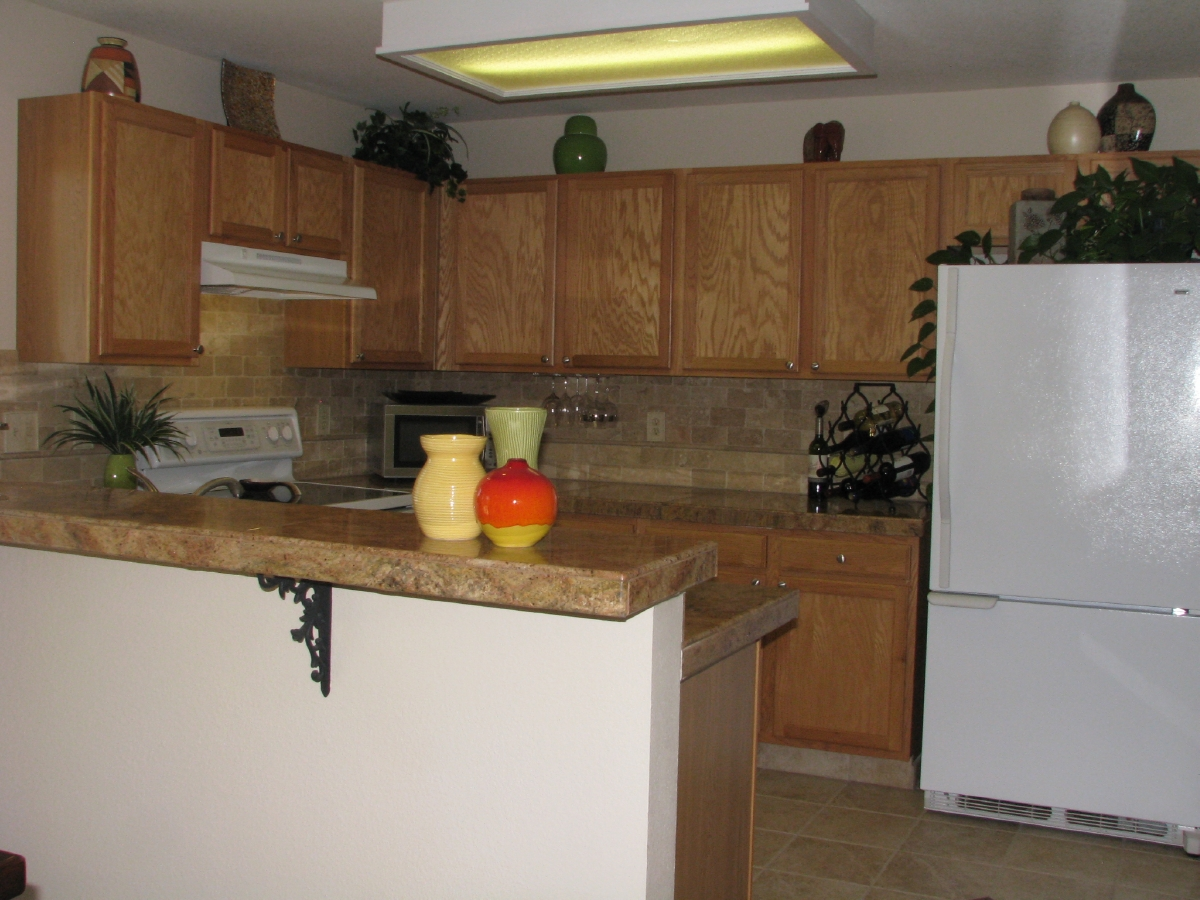 Kitchen with maple cabinets and granite counters