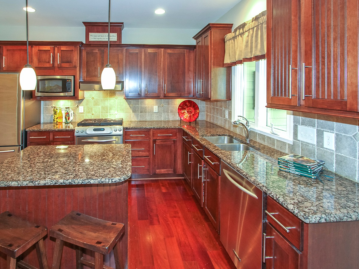 Granite countertops, tile backsplash, island