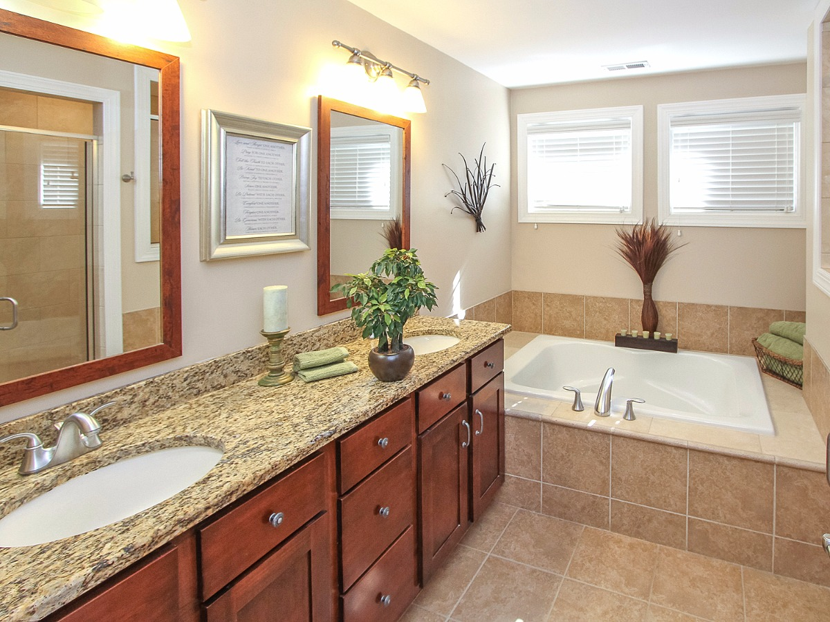 Master bath with tile, granite, dual sinks