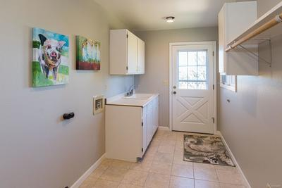 Laundry / Mud Room w/Garage & Exterior Deck Access