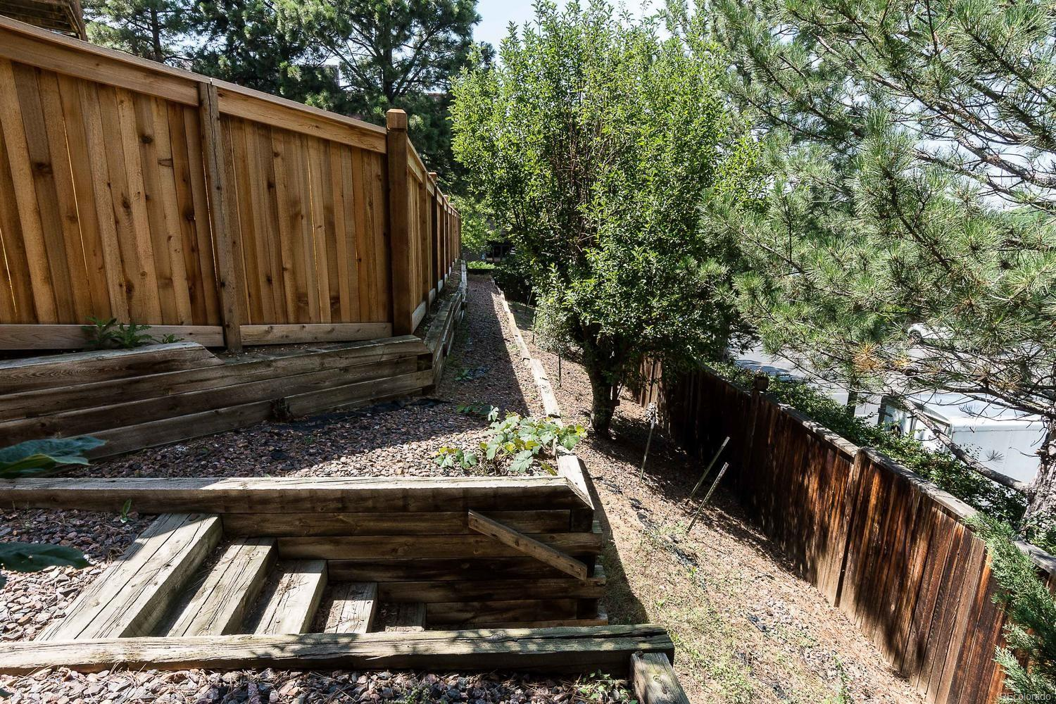 Newer fence, with extra space behind for additional gardening opportunities!