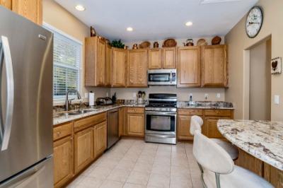 Kitchen Has Granite Breakfast/Serving Bar