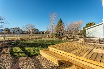 Deck Overlooks Fenced Back Yard
