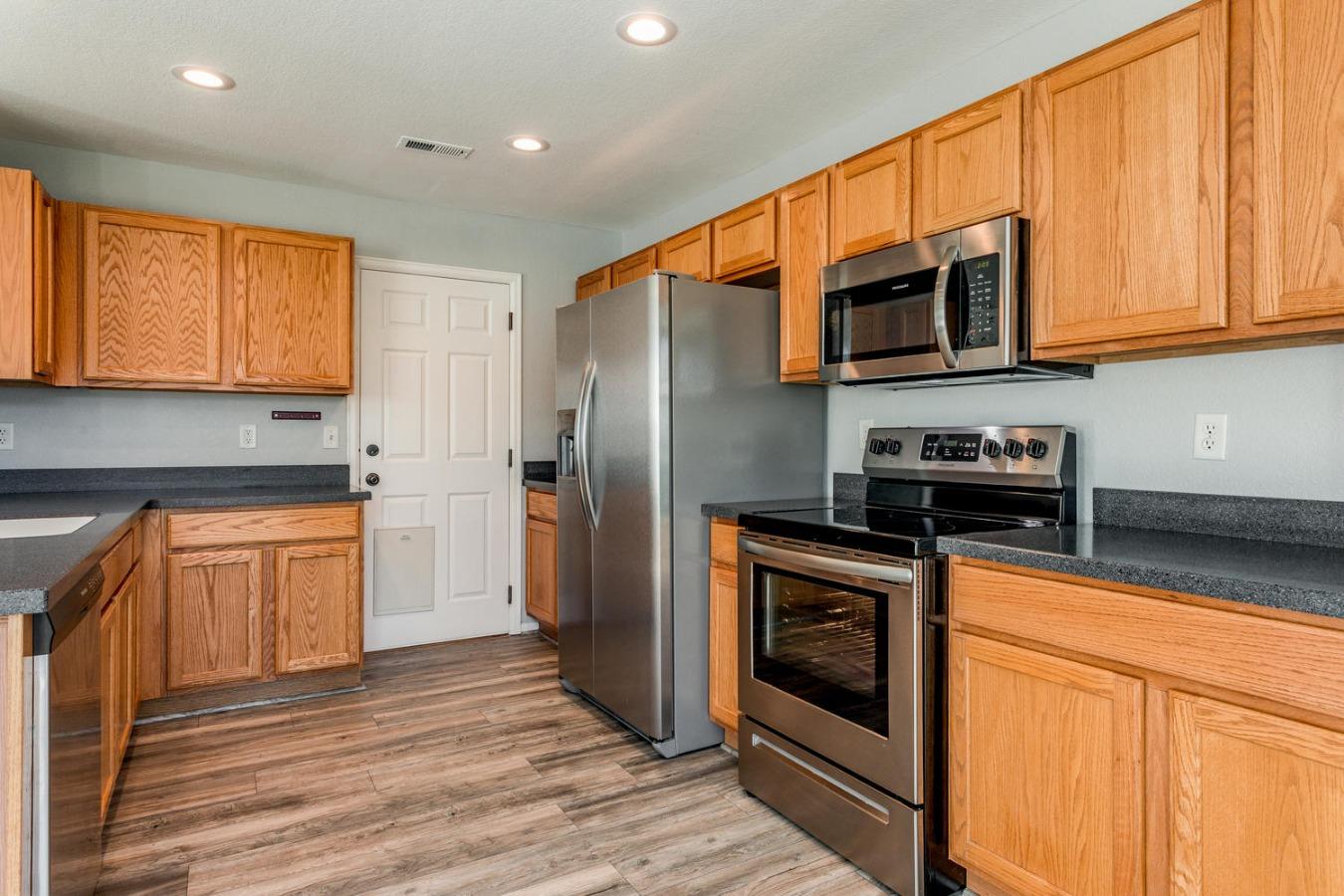Abundant Kitchen Cabinetry + Pantry