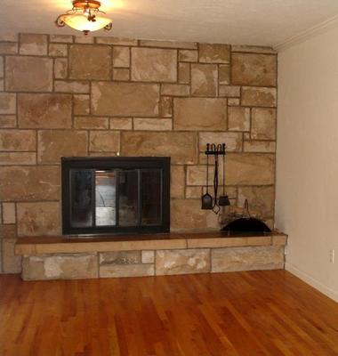 Wood burning fireplace with stone hearth