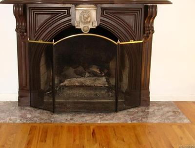 Gas fireplace with beautiful wood hearth