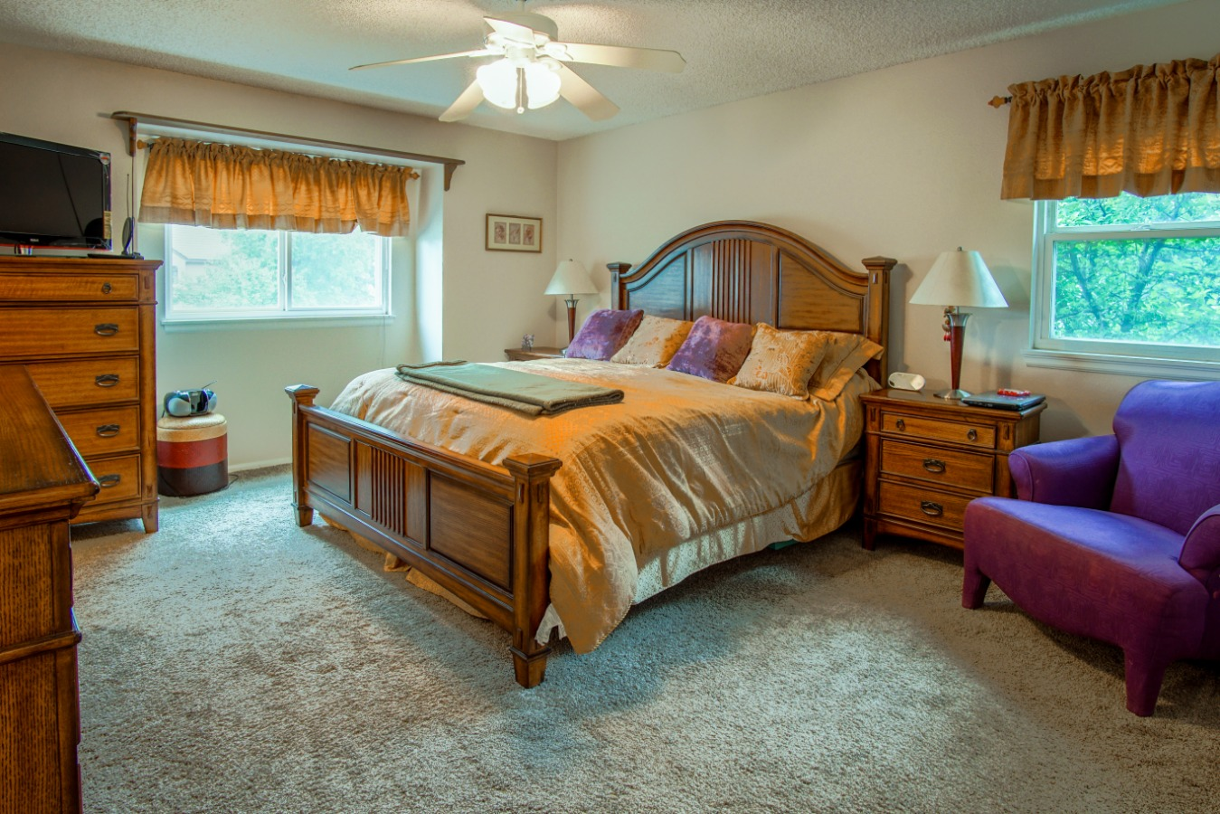 Master Suite with lots of light and a ceiling fan