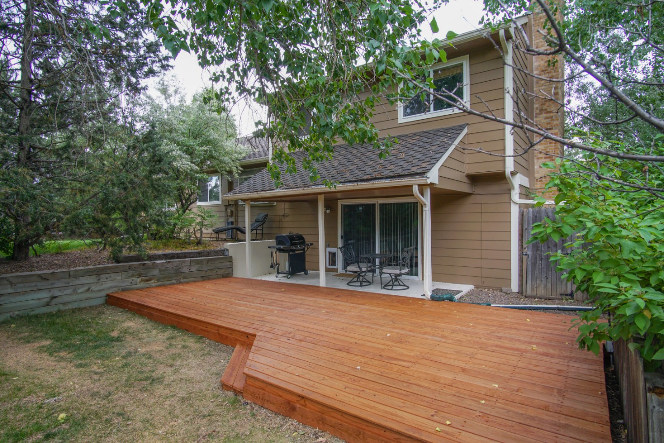 Beautiful yard with covered patio and wood deck