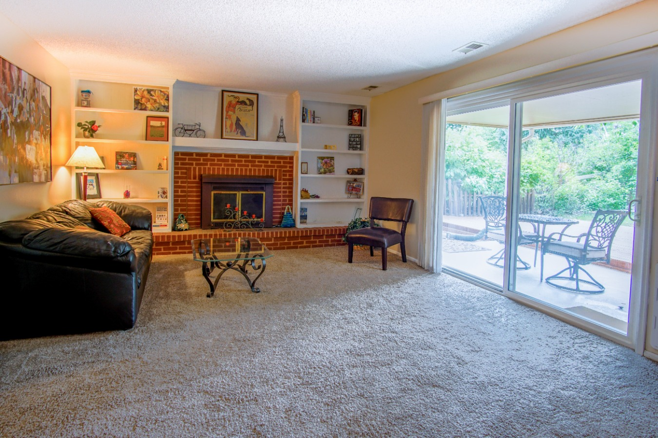 Family room has built in bookcases and fireplace