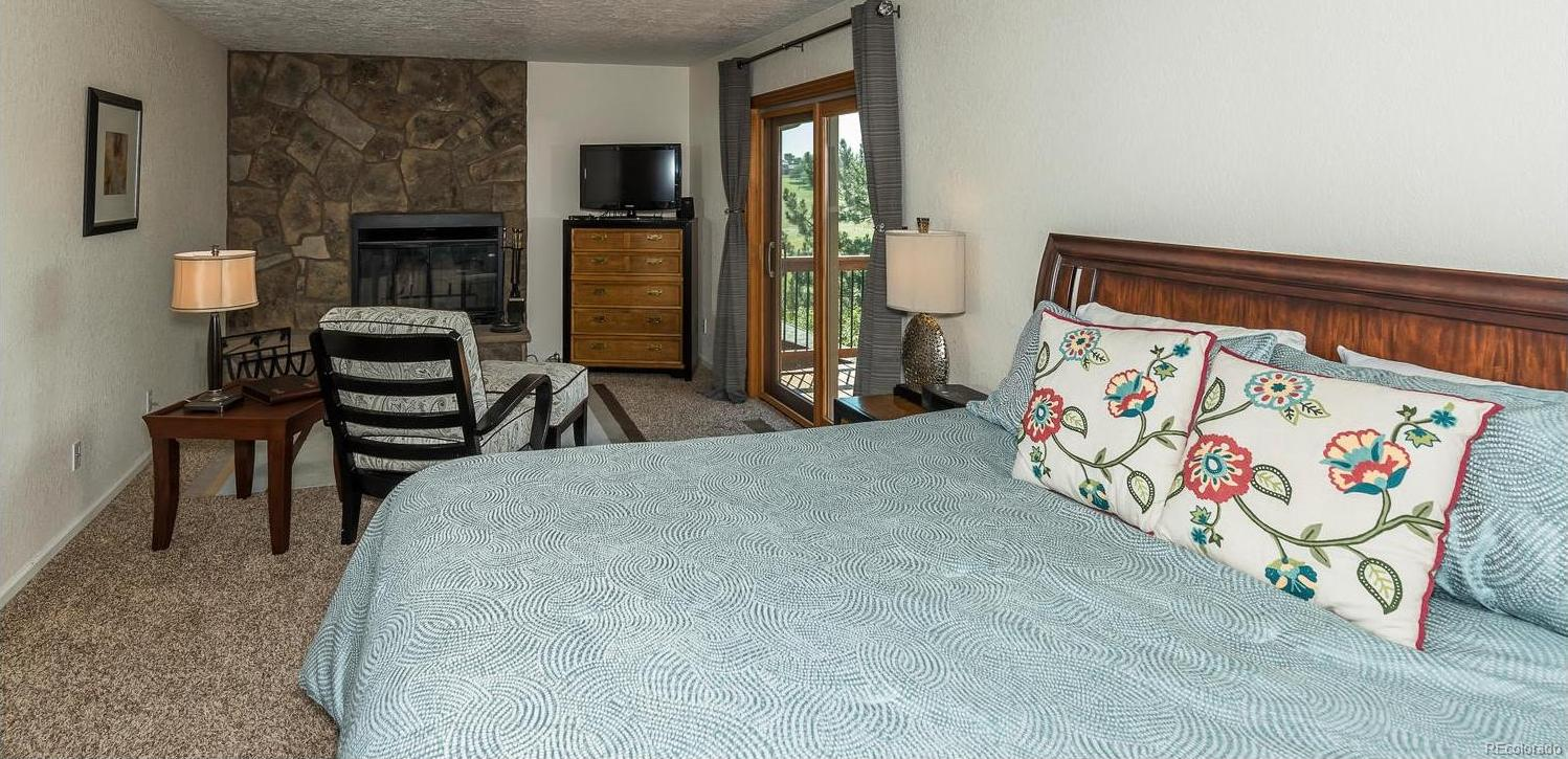 Master Suite with Large Retreat and Balcony Access