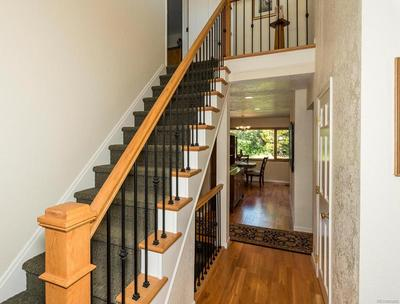 Open Staircase to Master Suite with Iron Railings
