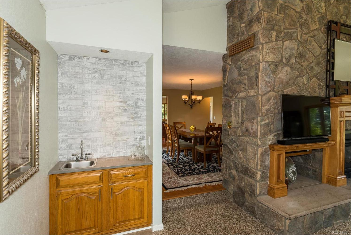 Newly Remodeled Wet Bar with Granite Countertop, New Sink and Faucet and Stone B