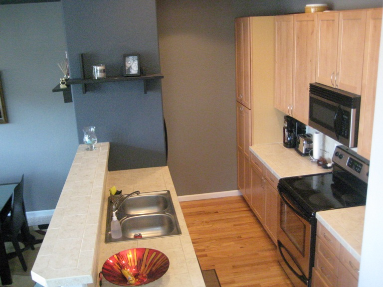 Kitchen has Maple cabinets and wood floor