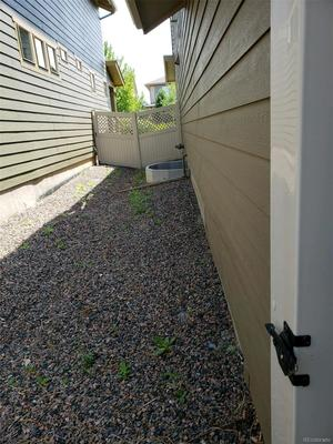 Side yard area to east of home would allow for dog run area