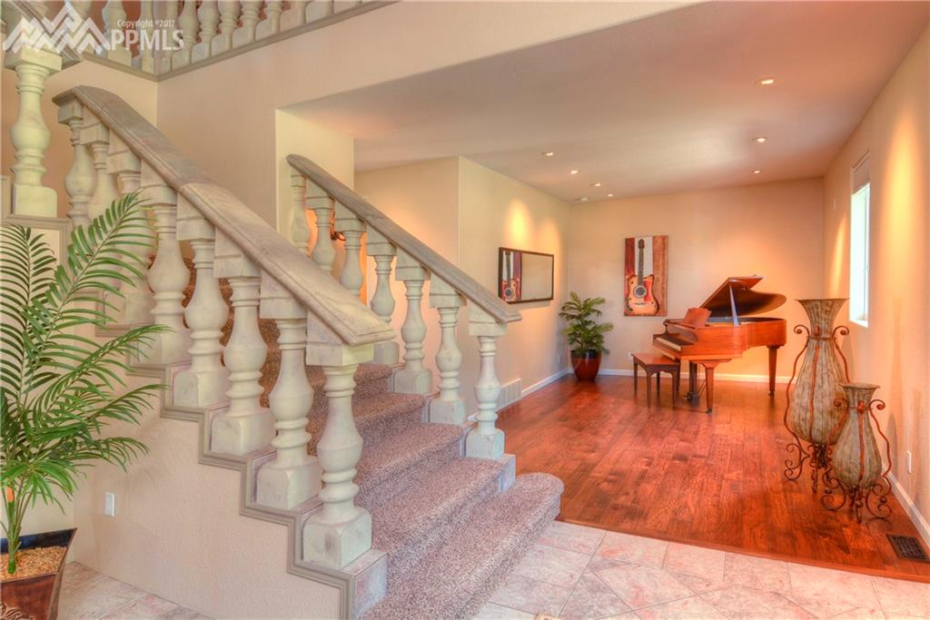 Formal living room used as a music room. A very nice greeting to this home.