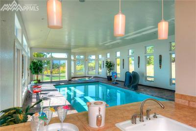 Oh how FUN!!!!! The pool house wing of the house with kitchenette, bath, sauna,