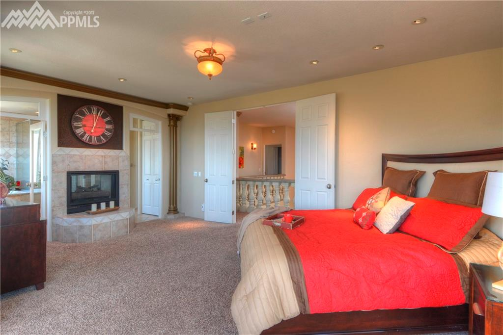 Luxurious Master Bedroom with fireplace and great views lounging in bed!