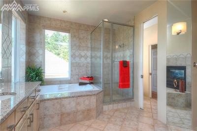 Recently remodeled Master bath with tub and separate shower, double vanity and f