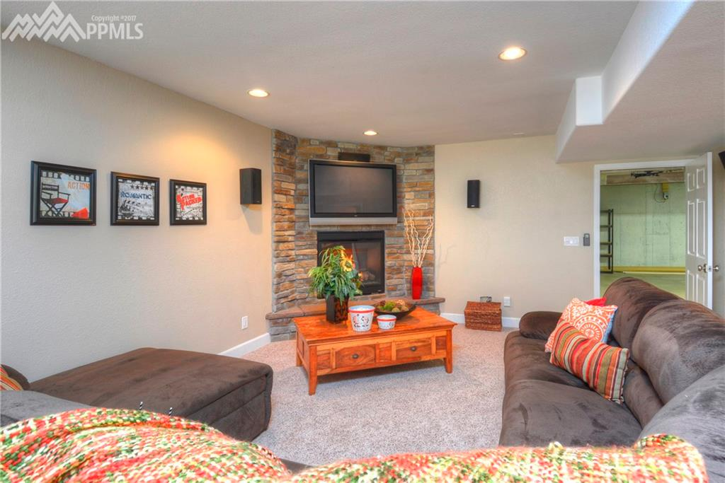 2nd Family room in basement (Mother-in Law quarters) with stone fireplace .