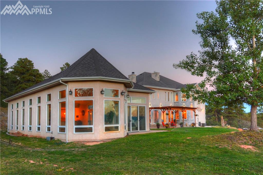 Stunning home on 5 acres with full sized indoor pool, covered patio and fabulous