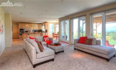 Main level Family room with stellar views of the mountain range and sparkling ci