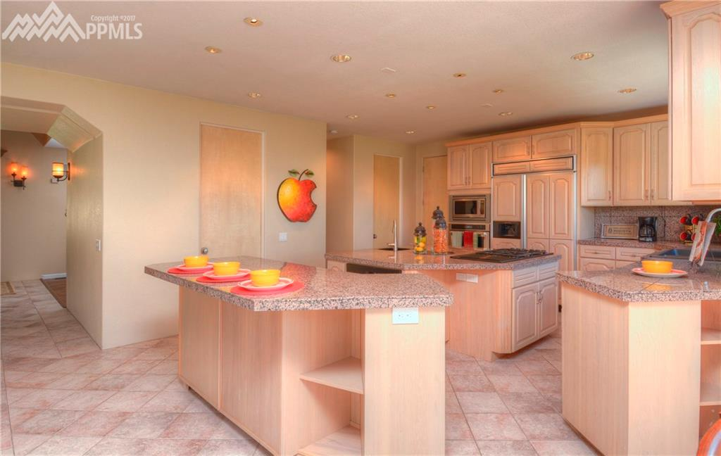 Spacious Island kitchen with eating bar and nook.