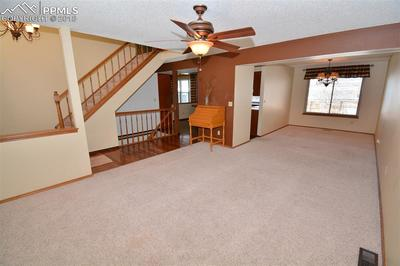 View of Upstairs, Downstairs, Kitchen and Dining Room from Living Room.